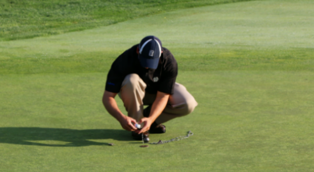 man coring a golf hole